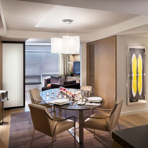 Conrad Suite is the largest suite featuring a sleek design and a separate dining area, perfect for entertaining friends in style.